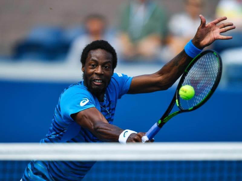 Gael Monfils of France makes a return during his win over Marcos Baghdatis of Cyprus. (AFP)