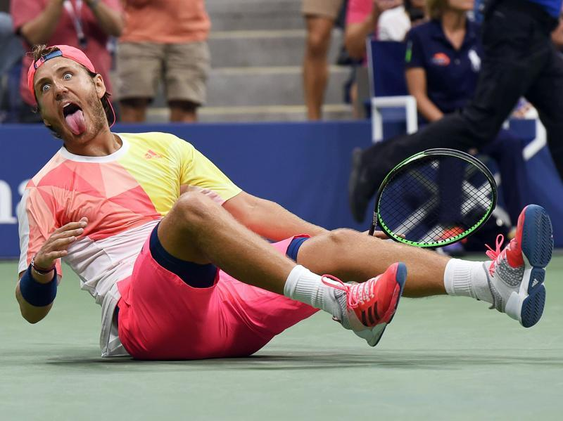Lucas Pouille of France celebrates defeating Rafael Nadal of Spain in the fourth round of the US Open at the USTA Billie Jean King National Tennis Center in New York on September 4, 2016. (AFP)
