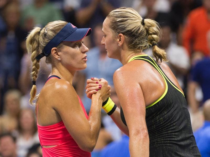 Angelique Kerber and Petra Kvitova embrace at the net after the match. (AFP)