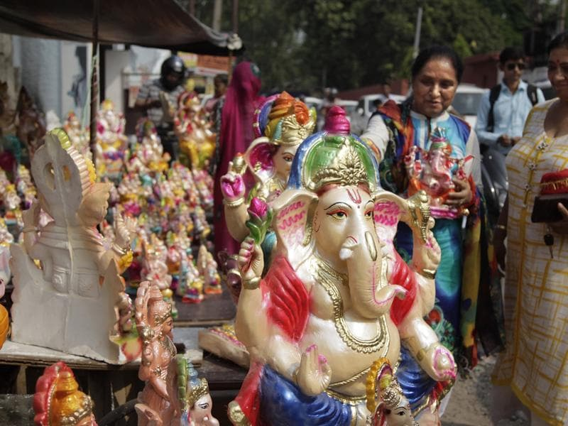 People look to buy idols of Lord Ganesha in Jammu.  (Channi Anand/AP)