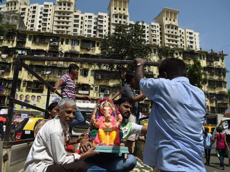 Ganesh Chaturthi celebration in a Mumbai colony. The 11-day festival  runs this year from September 5-15. (PUNIT PARANJPE/AFP)