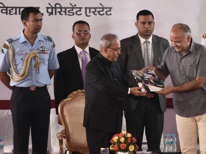 President Pranab Mukherjee receives a copy of 'Umang' from Delhi's deputy chief minister Manish Sisodia during a function at Dr Rajendra Prasad Sarvodaya Vidyalaya at President's Estate in New Delhi on Monday.   (Vipin Kumar/HT PHOTO)