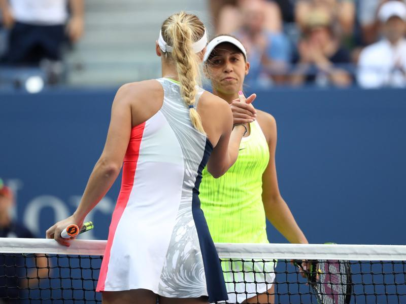Wozniacki shakes hands with Madison Keys after the match. (Reuters)