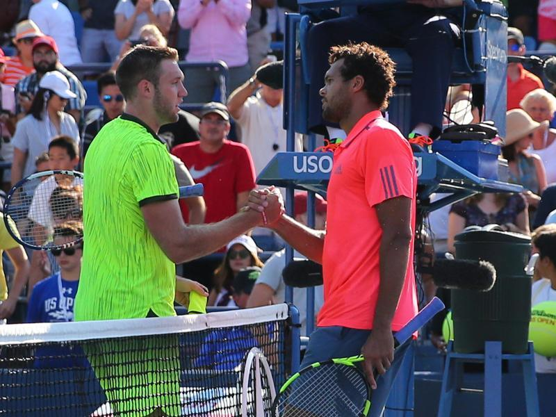 Tsonga shakes hands with Sock after the match. (Reuters)