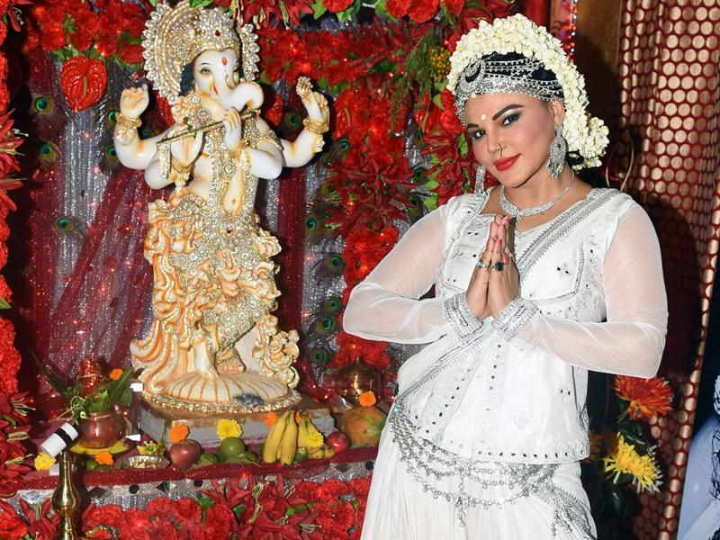 Rakhi Sawant posed for the shuttrebugs on Ganesh Chaturthi. (AFP)