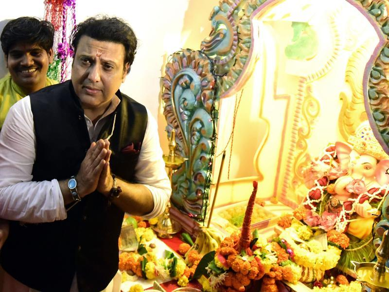 Govinda poses alongside a statue of Lord Ganesh on Ganesh Chaturthi in Mumbai. (AFP)