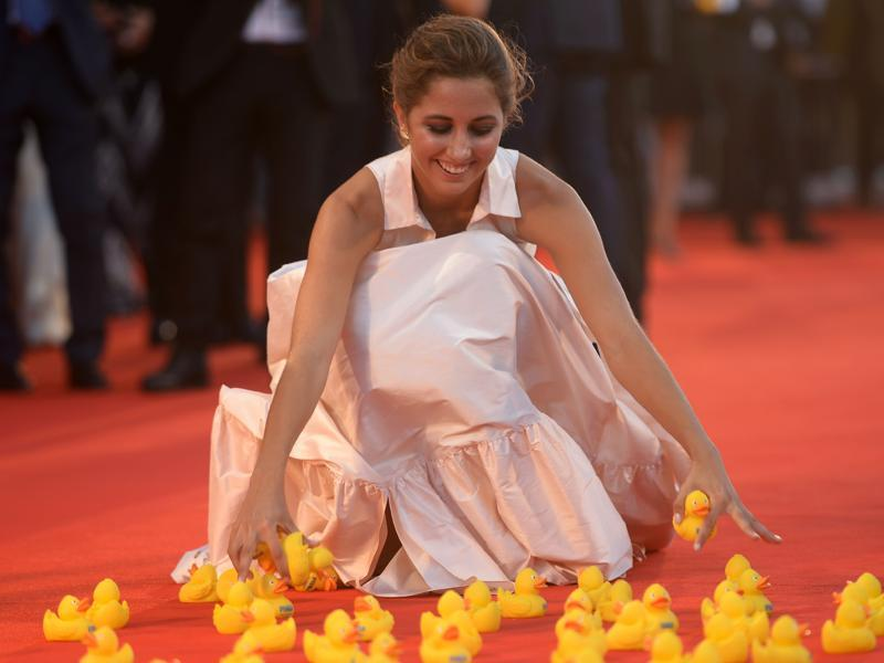 Actor Blu Yoshimi plays with yellow rubber ducks as she arrives at the premiere of the movie Piuma presented in competition at the 73rd Venice Film Festival on September 5. (AFP)