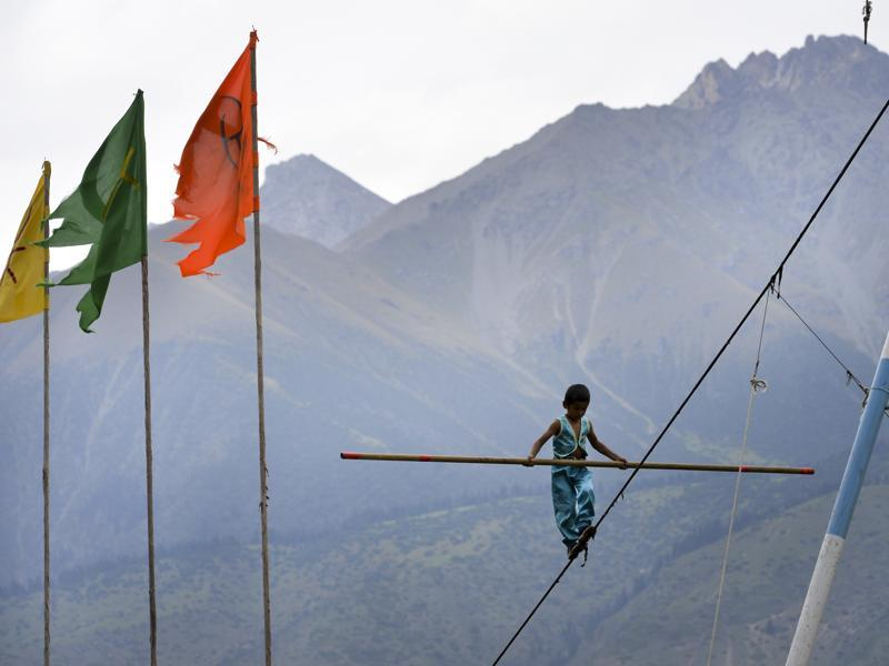 A boy performs a tight-rope walk during the second World Nomad Games. (AP photo)