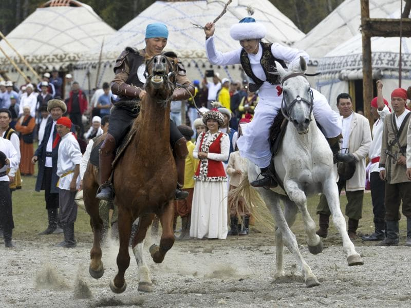Participants take part in a horse-riding competition. (AP photo)