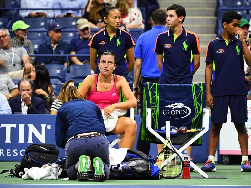 Sevastova receives treatment during a medical timeout. After falling and twisting her ankle, the Latvian couldn't get back into the match. (AFP)