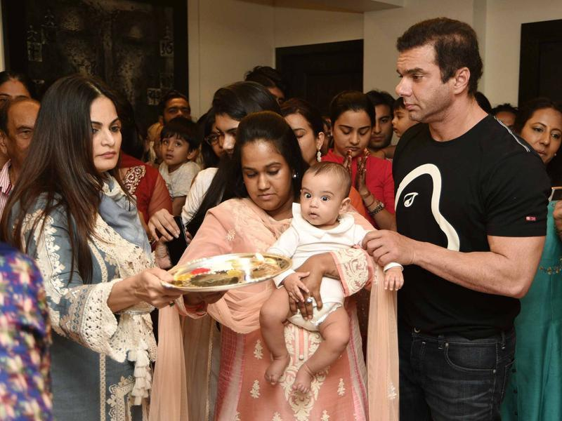 Arpita and Sohail perform aarti during Ganesha pooja on Tuesday in Mumbai. (Yogen Shah)