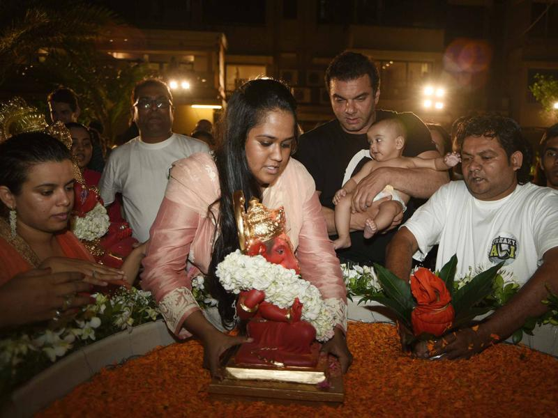 Arpita Khan Sharma immerses the idol of Ganesha as brother Sohail holds her son. The family celebrated Ganesha festival this year without Salman Khan because the actor is currently in Manali shooting for Kabir Khan's Tubelight. (Yogen Shah)