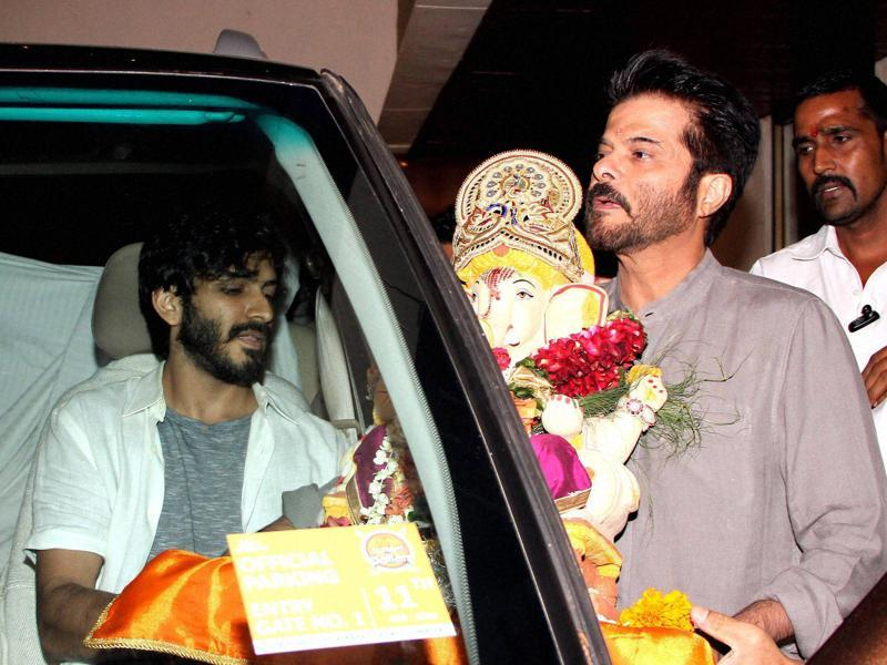 Anil Kapoor with son Harshvardhan Kapoor participates in a procession for the immersion of an idol of Lord Ganesha in Mumbai on Tuesday.  (PTI)