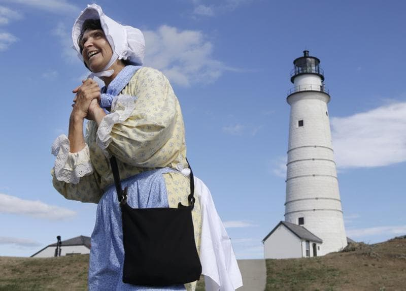 Sally Snowman, the keeper of Boston Light, wears Revolutionary-era clothing as she speaks about its history on Little Brewster Island in Boston Harbour.  (AP)