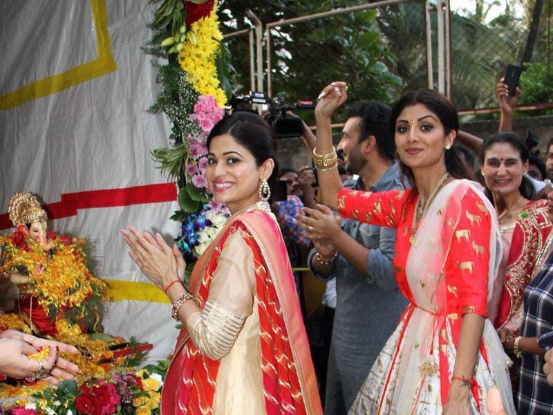 Sisters Shilpa and Shamita Shetty participate in enjoy during a procession for the immersion of an idol of Lord Ganesha in Mumbai. (PTI)