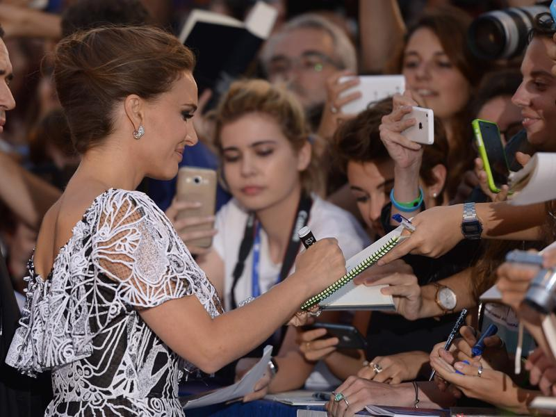 Actress Natalie Portman signs autographs before the premiere of the movie