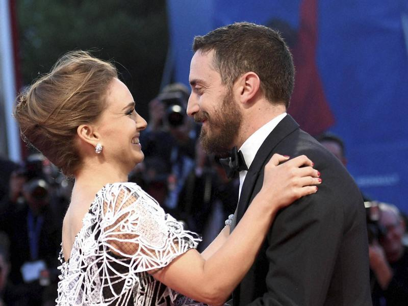 Actress Natalie Portman, left, and director Pablo Larrain (right) hug each other upon their arrival on the red carpet for the premiere of the movie 'Jackie' during the 73rd Venice Film Festival.  (AP)