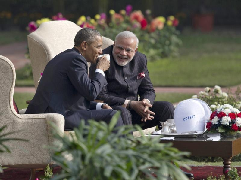 President Obama and Prime Minister Narendra Modi have coffee and tea in the gardens of the Hyderabad House in Delhi on January 25, 2015 . (AP)