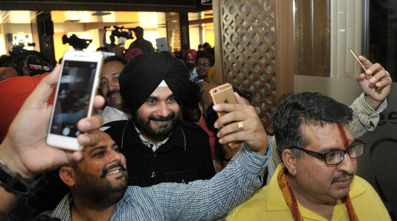 Sidhu with supporters after the press conference in Chandigarh on Thursday. (Ravi Kumar/HT Photo)