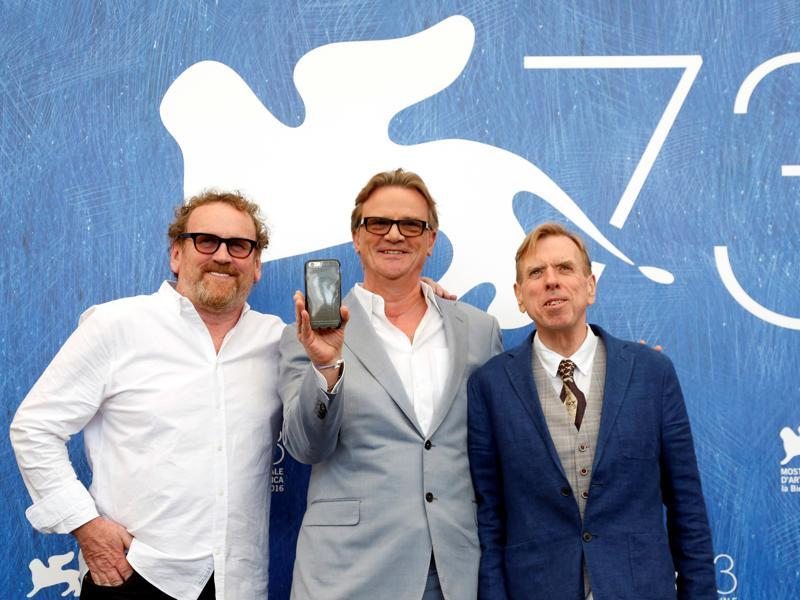 Director Nick Hamm (C) poses with actors Colm Meaney (L) and Timothy Spall as they attend the photocall for the movie