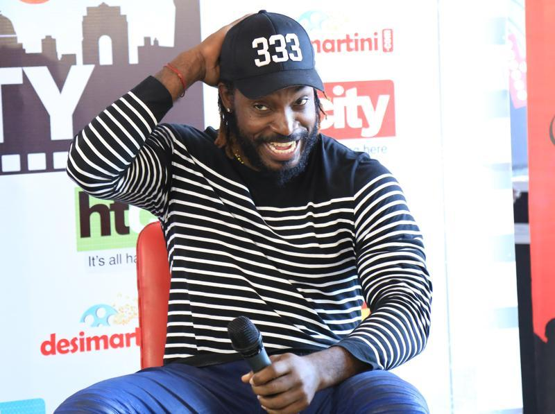 Jamiaca-born cricketer Chris Gayle visited HT House on Friday to meet the winners of HT City Stars in the City Contest and to promote his new book, Six Machine. (Zabeeh Afaque/HT Photo )