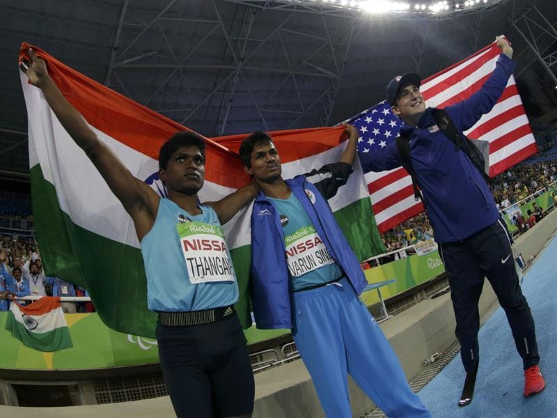 Gold medallist Mariyappan Thangavelu,bronze medal winner Varun Singh Bhati and silver medallist Sam Grewe of the United States celebrate their wins. (REUTERS)