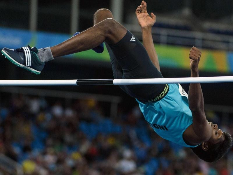 India's Mariyappan Thangavelu jumps in the men's final high jump - T42 during the Paralympic Games at the Olympic Stadium in Rio de Janeiro on September 9, 2016.  (AFP)
