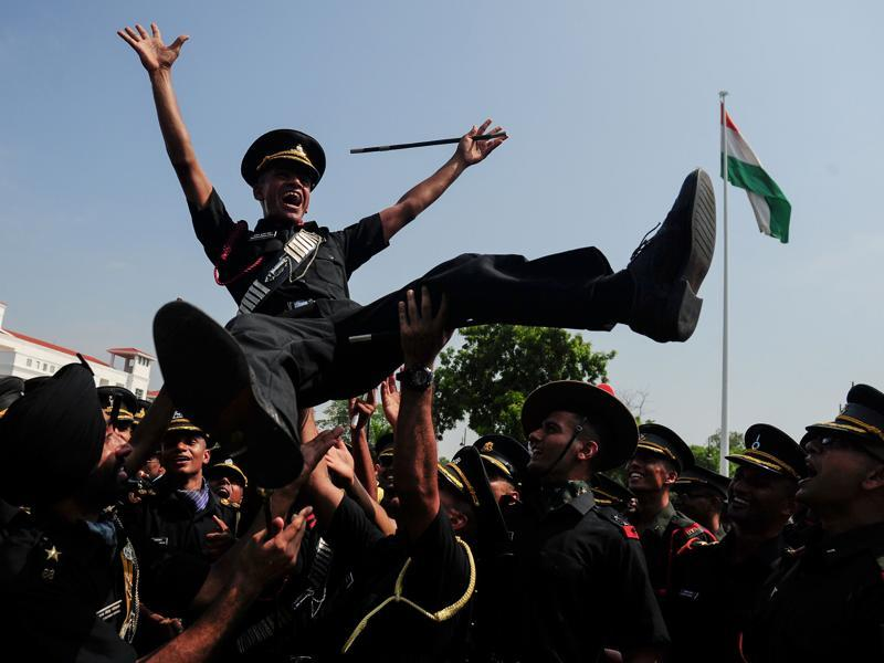 Indian army cadets celebrate after their graduation ceremony at the Officers Training Academy in Chennai on September 10, 2016. A total of 249 cadets, including 32 women, graduated from the academy and will be posted as lieutenants in the Indian Army. (AFP)
