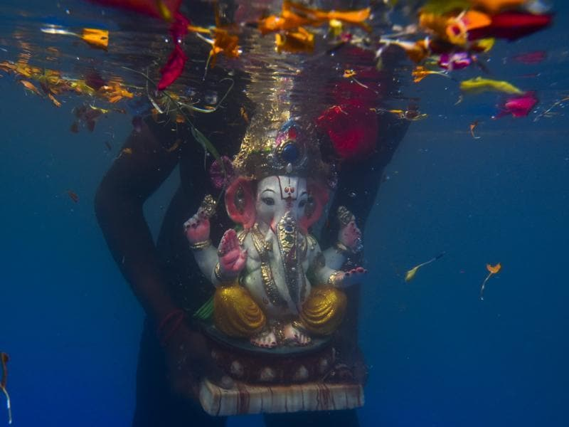 An idol of elephant-headed Hindu god Ganesha floats after it was immersed in an artificial pond during Ganesh Visarjan at Sion in Mumbai, India, on Tuesday, September 6, 2016. (Satish bate/HT photo)