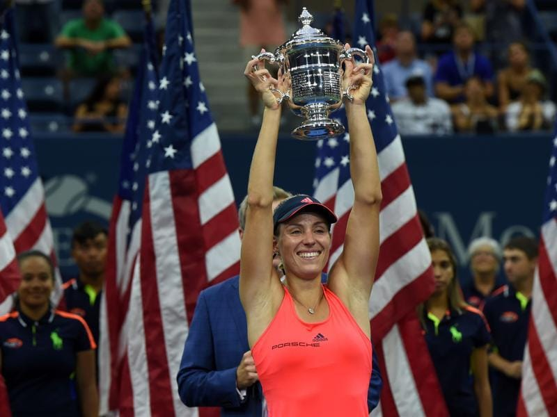 Angelique Kerber of Germany holds up her winning trophy after defeating Karolina Pliskova of Czech Republic in the 2016 US Open women's Singles final match at the USTA Billie Jean King National Tennis Center in New York on September 10, 2016. New world number one Kerber won with a battling 6-3, 4-6, 6-4 victory over Pliskova. (AFP)