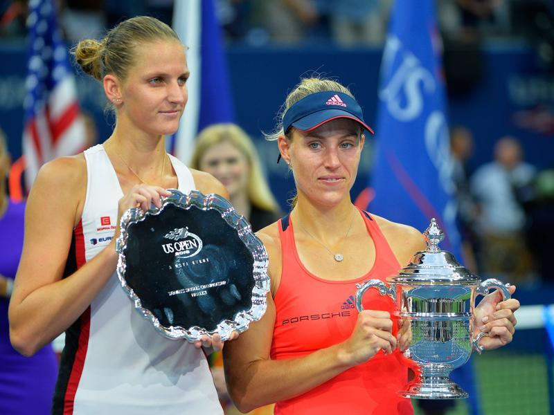 Kerber (R) and Pliskova pose with their trophies during the presentation ceremony. (AFP)