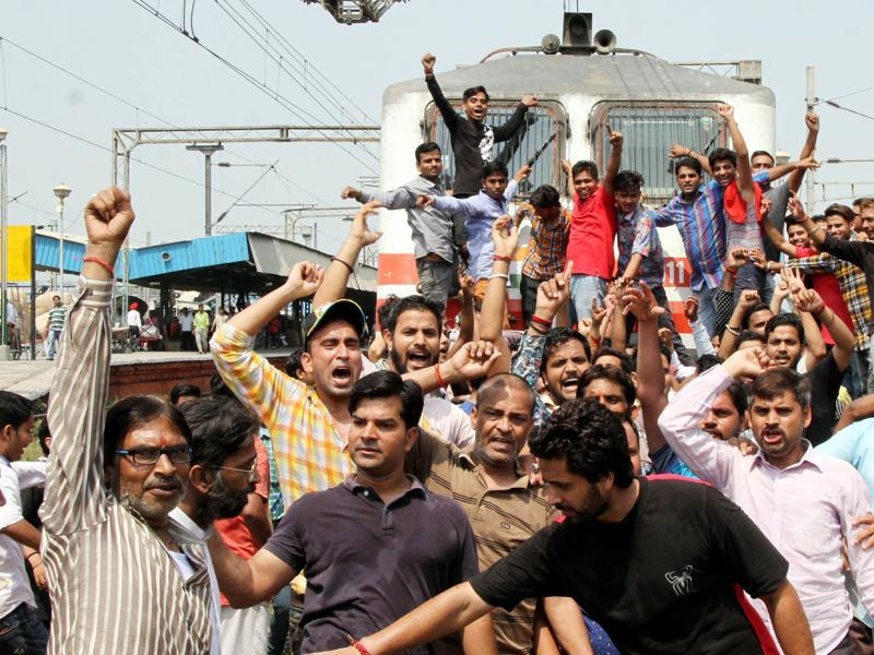The protesters raising slogans in front of a train that was stopped on Monday. (JS Grewal/HT Photo )