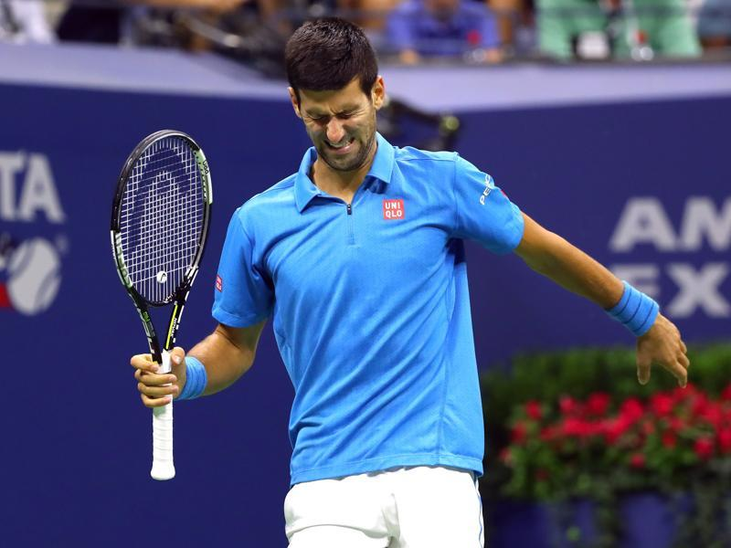 Novak Djokovic of Serbia grimaces after taking medical time to check a toe injury/ (NYT Photo)