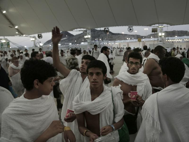 Saudi Muslim pilgrims make their way to cast stones at a pillar symbolising the stoning of Satan, in a ritual called