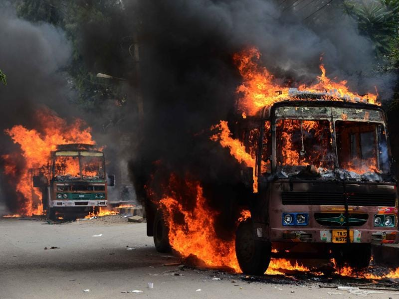 Protesters burnt more than 15 trucks and vehicles from Tamil Nadu, in Bengaluru. (Kashif Masood/HT Photo)