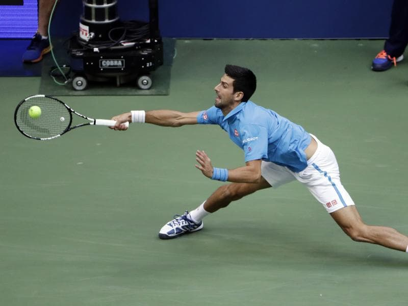 Novak Djokovic, of Serbia, returns a shot. (AP photo)