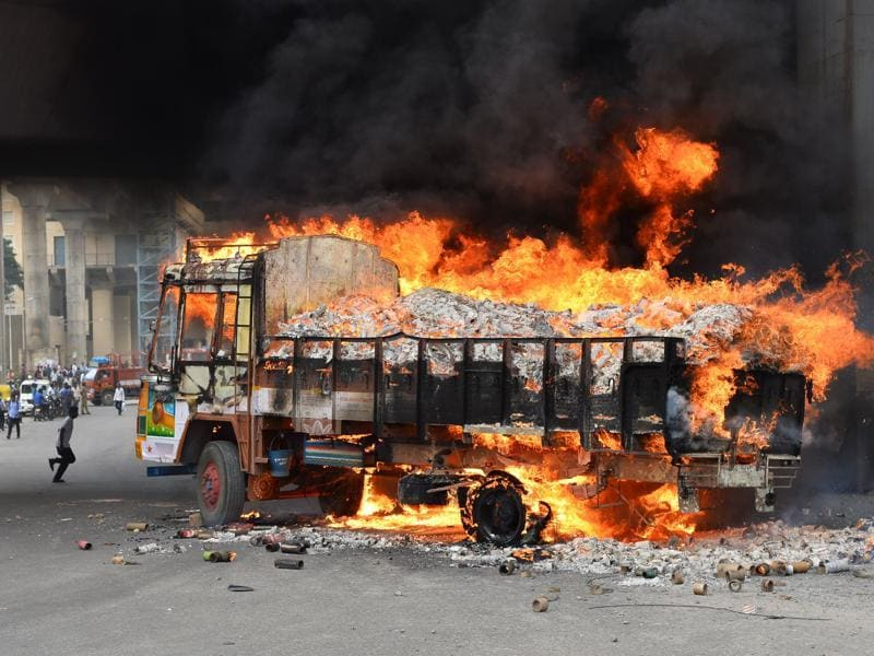 A truck from Tamil Nadu burns after it was set alight by agitated pro-Karnataka activists. (AFP Photo)