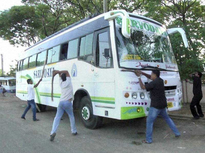 Tamil activists vandalise a bus from Karnataka as they protest over Cauvery water row, in Rameshwaram. (PTI Photo)