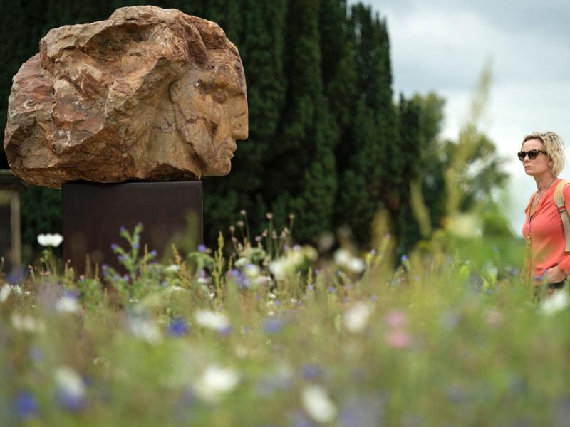 A sculpture titled 'Red Mountain Head' by British artist Emily Young features in the 'Beyond Limits' exhibition in the grounds of Chatsworth House near Bakewell, northern England. The exhibition will be on from September 10 till October 30. (AFP)