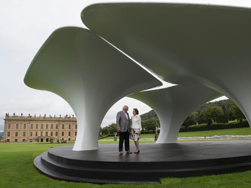 Duke of Devonshire Peregrine Cavendish and his wife Amanda pose for a photograph in front of an installation by British architect Zaha Hadid titled Lilas, featuring in the 'Beyond Limits' exhibition. (AFP)