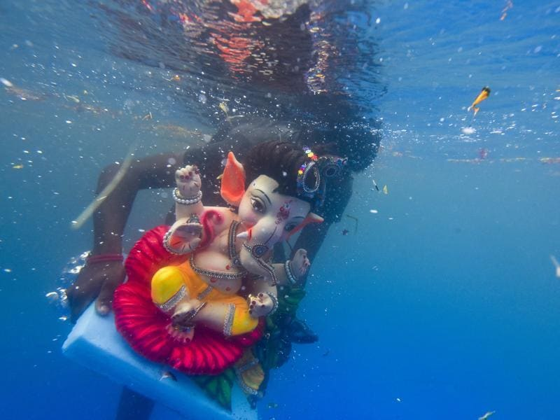 An idol of Lord Ganesha floats after it was immersed in an artificial pond at Sion in Mumbai. (Kunal Patil/HT Photo)