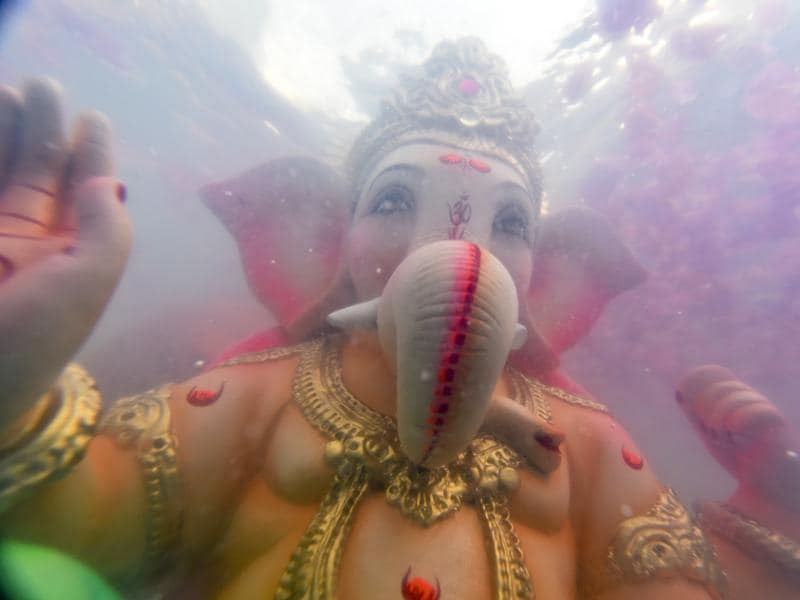 An idol of elephant-headed Hindu god Ganesha floats after it was immersed in a artificial pond during 6th day of Ganesh visarjan at Dadar Beach in Mumbai, India, on Saturday, September 10, 2016. (Kunal Patil/HT Photo)