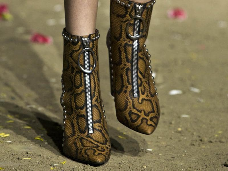 Snakeskin, studs and exposed zips gave the ankle boots at Phillip Lim some serious attitude. (AFP)