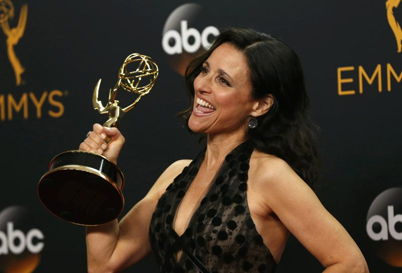 Actress Julia Louis-Dreyfus poses backstage with her award for Outstanding Lead Actress In A Comedy Series for her role in HBO's