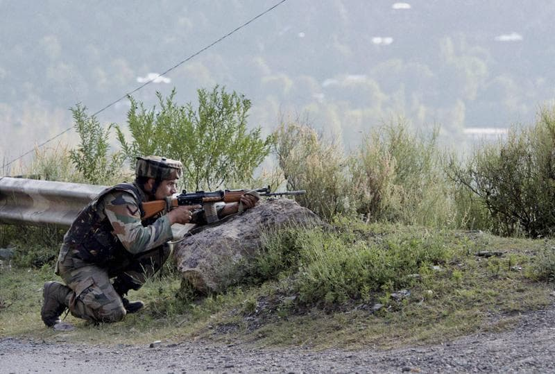 A soldier near the Army Brigade camp during a terror attack. (PTI Photo)