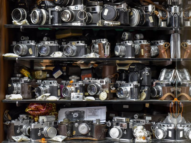 A view of one of Dilish Parekh's cupboard displays of rangefinder cameras. Parekh started with 600 cameras, passed onto him by his father. Over the next 25 years, his collection grew by leaps and bounds, and he became the world record holder when he reached 2,634 cameras.  (Kunal Patil/Hindustan Times)