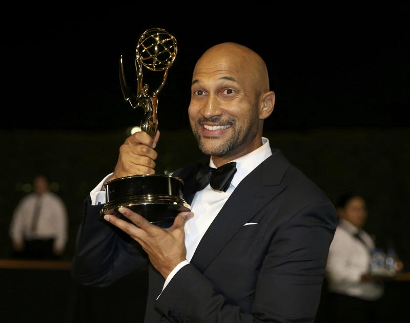 Keegan-Michael Key holds the award for Outstanding Variety Sketch Series for Key & Peele as he arrives at the Governors Ball after the 68th Primetime Emmy Awards. (REUTERS)