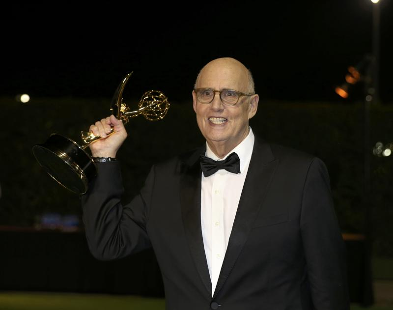Jeffrey Tambor holds his award for Outstanding Lead Actor In A Comedy Series for Transparent as he arrives at the Governors Ball after the 68th Primetime Emmy Awards. (REUTERS)