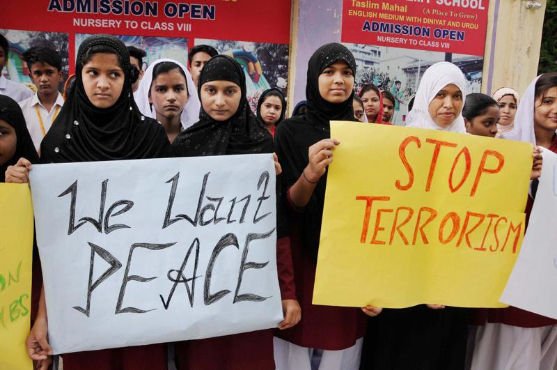 School students hold placards during a protest against terror attack at Uri Army base in Ranchi.  (PTI)