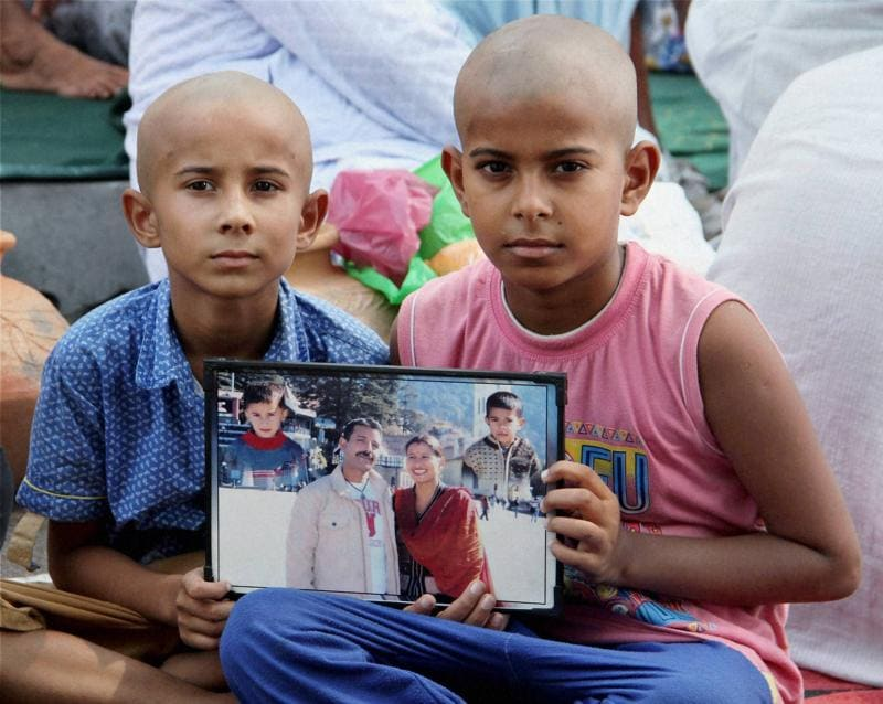 Sons of Havildar Ravi Paul who was martyred in Sunday's terrorist attack at Uri Army camp at their native village  Sarwa in Samba on Monday (PTI)